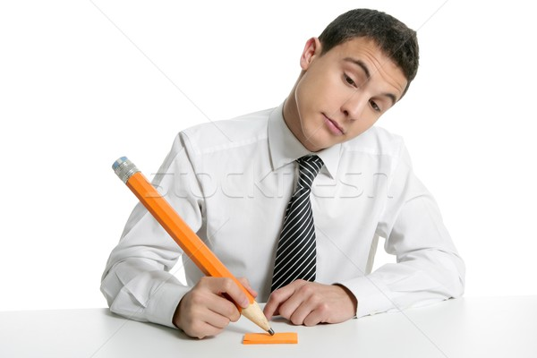 317068_stock-photo-young-businessman-student-thinking-with-pencil